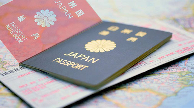 Japanese Passport, Airplane Ticket and a Map